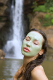 Woman with green clay facial mask in beauty spa (Outdoor) Royalty Free Stock Image