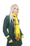 Woman in green coat. And yellow scarf Stock Photo