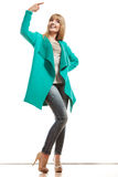 Woman in green coat showing copy space Royalty Free Stock Images