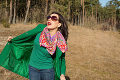 Woman in green coat walks on nature Royalty Free Stock Photography