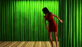 Woman and green curtain stage Stock Image