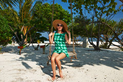 Woman in green dress at beach Stock Photos