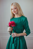 Woman in a green dress Stock Images