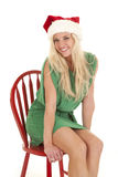 Woman green dress big smile santa hat Royalty Free Stock Photography
