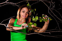 Woman in a green dress between dry branches Stock Photos