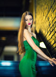 Woman in green dress going down by stairs Royalty Free Stock Image