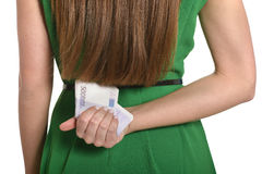 Woman in green dress with money Stock Photo