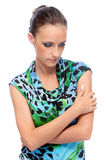 Woman in green dress reflects Royalty Free Stock Image