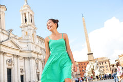 Woman in green dress in Rome, Italy stock photography
