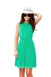 Woman in green dress and sun hat Stock Images