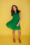 Woman In Green Dress Twirling Her Skirt Stock Photos