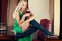 Woman in a green dress with a wine glass Royalty Free Stock Photos