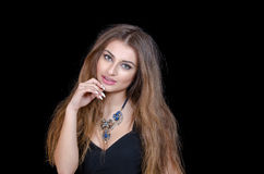 Woman with green eye contact lens , long hair and big necklace Stock Photo