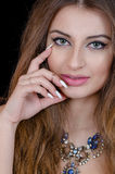 Woman with green eye contact lens , long hair and big necklace Stock Photos