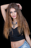 Woman with green eye contact lens , long hair and big necklace Royalty Free Stock Image