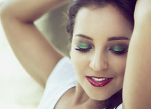 Woman with green eye shadows Royalty Free Stock Images