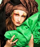 Woman and green fabric Royalty Free Stock Photo
