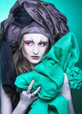 Woman and green fabric Royalty Free Stock Image
