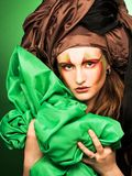Woman and green fabric Royalty Free Stock Images