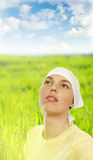 Woman on green field Royalty Free Stock Image
