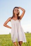Woman on green field. Beautuful woman walking on green field Royalty Free Stock Image