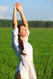 Woman in green field. Young happy woman in green field Royalty Free Stock Images