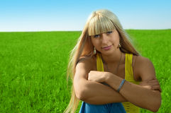 Woman in green field Stock Images