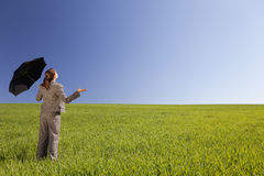 Woman In A Green Field With An Umbrella Royalty Free Stock Photo
