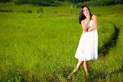 Woman on green filed Stock Images