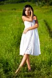 Woman on green filed Stock Photography