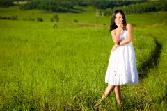 Woman on green filed Stock Photos