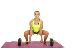 Woman green fitness tank top dead lift front Stock Photos