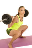 Woman green fitness tank top squat side low Stock Image