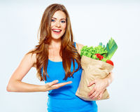 Woman with green food points a finger at the product Royalty Free Stock Image