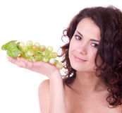 Woman with green grape Royalty Free Stock Images