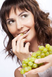 Woman with green grapes Royalty Free Stock Photo