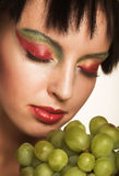 Woman with green grapes Stock Photo