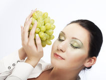 Woman with green grapes Stock Images