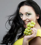 Woman with green grapes Royalty Free Stock Image