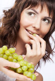 Woman with green grapes Royalty Free Stock Photos