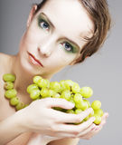 Woman with green grapes Royalty Free Stock Photography
