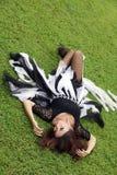 Woman on green grass. Woman lie down on green grass Stock Image