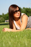Woman on green grass Stock Photography