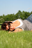 Woman on green grass Royalty Free Stock Images