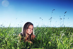 Woman on green grass Stock Photos