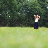 Woman on green grass field Royalty Free Stock Images