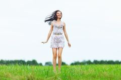 Woman on green grass field Stock Photos