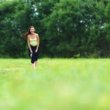 Woman on green grass field Royalty Free Stock Photos