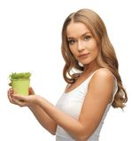 Woman with green grass in pot Stock Photos