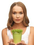 Woman with green grass in pot Stock Photography